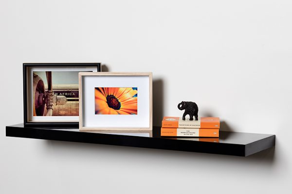 Flexi Storage Decorative Shelving Floating Shelf Black Gloss 900 x 240 x 38mm fitted on wall with decorations on top