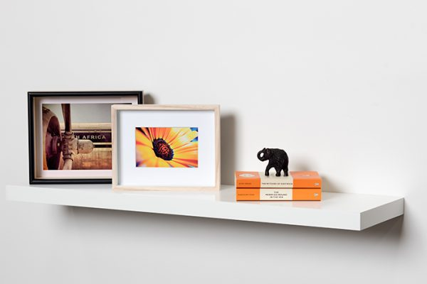Flexi Storage Decorative Shelving Floating Shelf White Gloss 900 x 240 x 38mm fitted on wall with decorations on top