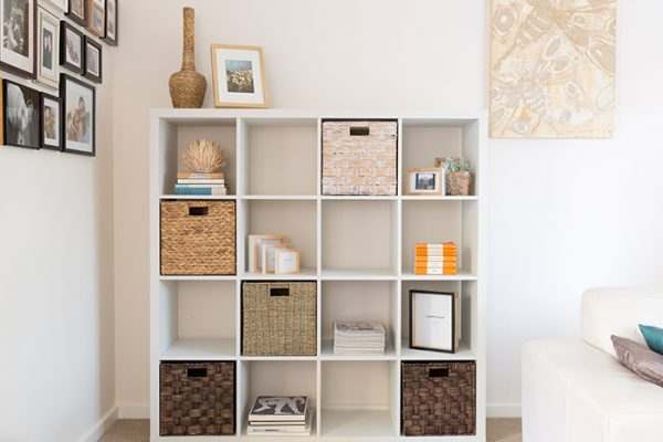 Flexi Storage Clever Cube 4 x 4 Cube White Storage Unit filled with Clever Cube Inserts, books and and decorative pieces in a living room