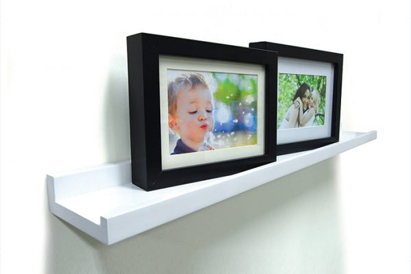 Flexi Storage Decorative Shelving Photo Shelf 1200x100x35mm fitted on wall with several photos on the shelf