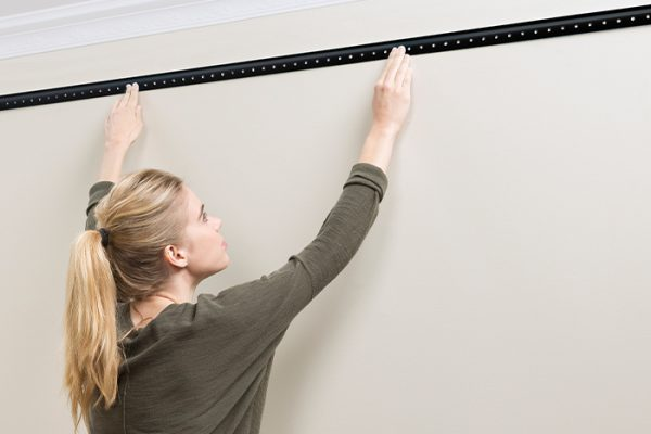 Flexi Storage Home Solutions Hang Track Black being installed onto wall