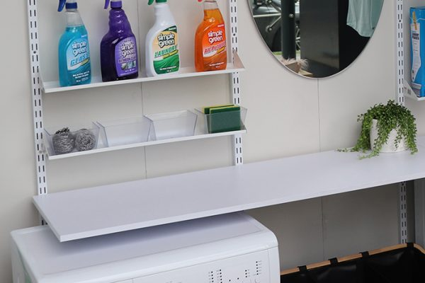 Flexi Storage Home Solutions Tray Shelf Plastic Tube Clear placed on Tray Shelf in laundry setup