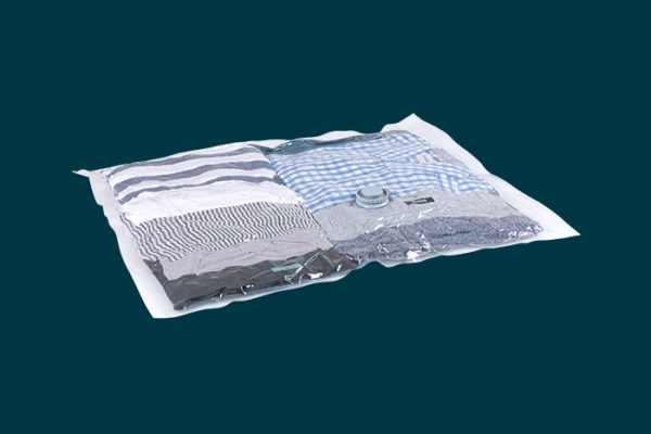 Flexi Storage Vacuum Storage Bag filled with clothing and compressed isolated