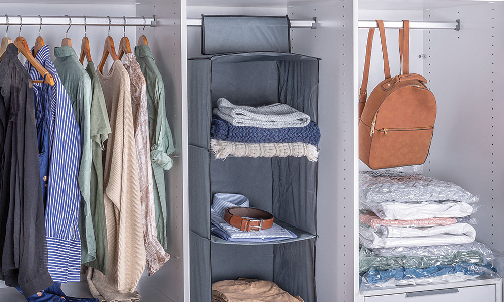 Flexi Storage Hanging Organiser & Vacuum Storage Bags in a wardrobe