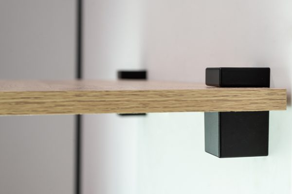 Flexi Storage Decorative Shelving Cube Shelf Clip Matt Black 2 Pack installed onto wall and supporting a timber shelf - side view